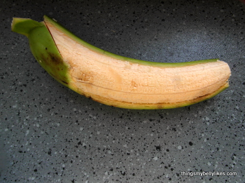peeling the raw banana