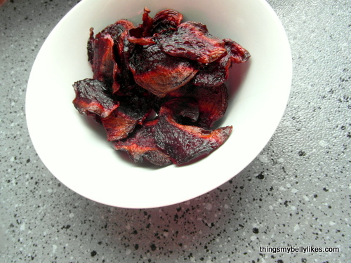 they're not burnt - the colour just darkens as they roast