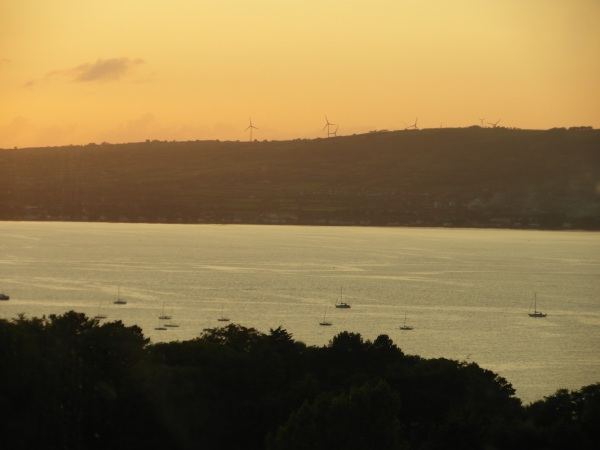 wind turbines overlooking Belfast Lough at dusk
